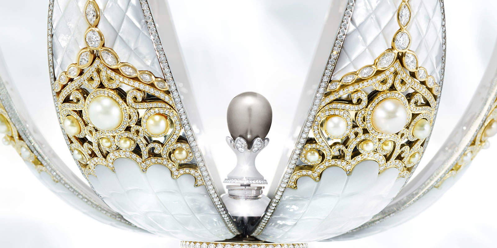 Close up view of the Faberge Pearl Egg in open-state, with pearls, white diamonds, and mother of pearl exterior