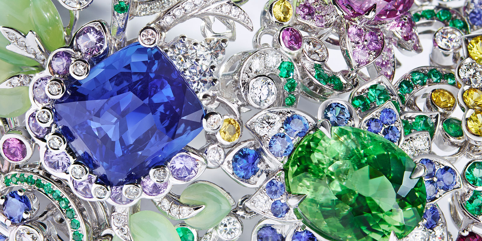Close up image of faberge jewellery, featuring large and small multi-coloured gemstones