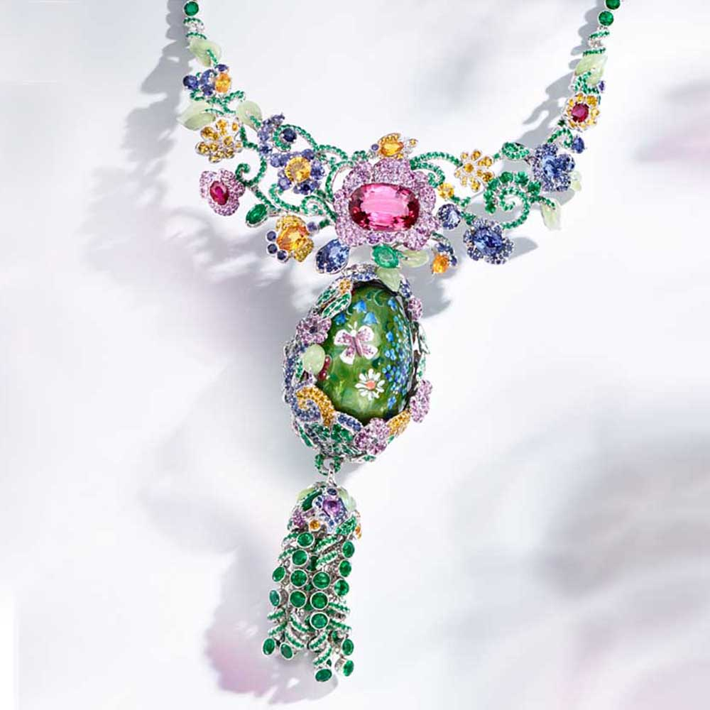 Image: Floral design Faberge Egg Pendant Necklace with multi-coloured gemstones. Text: High Jewellery