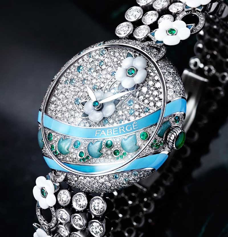 Ladies timepiece with multiple gemstones. Fabergé Exceptional Creations.