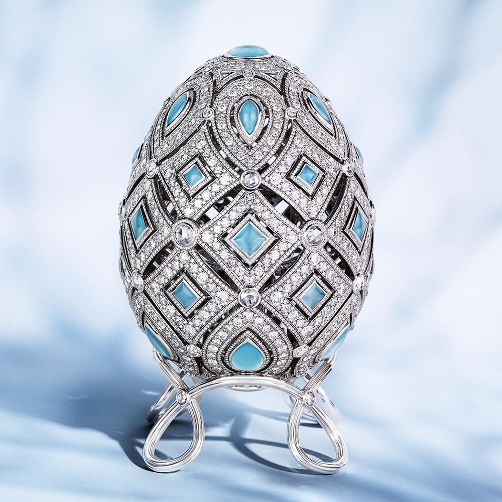 Image: Faberge Four Seasons Winter Egg decorated with white diamonds and blue gemstones. Text: Objets D'Art
