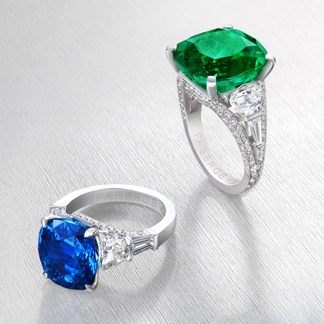 Two rings from the three colours of love collection. One blue sapphire and white diamonds ring, one green emerald and white diamonds ring.