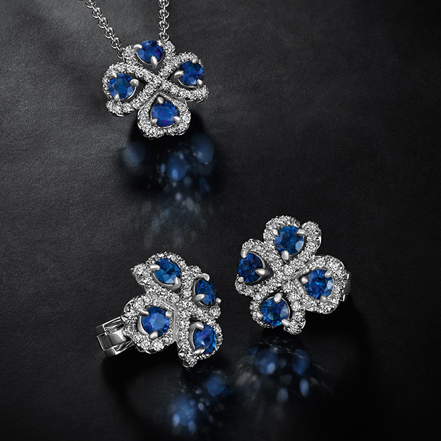 A pair of blue sapphire and white diamonds quadrille earrings, and one blue sapphire and white diamonds quadrille pendant from the Fabergé Imperial Collection.