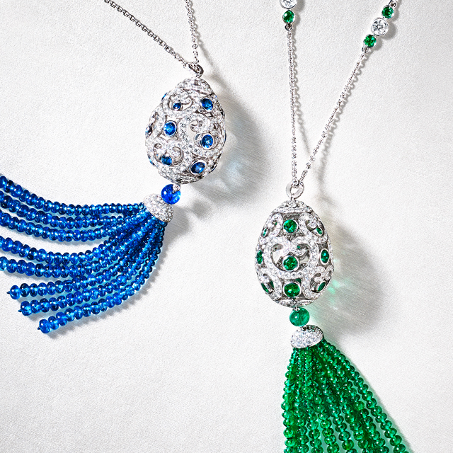 Two tassel pendants from the Fabergé Imperial Collection: blue sapphire and white diamond pendant with blue sapphire beads tassel pendant. Green emerald and white diamonds pendant with green emerald beads tassel pendant.