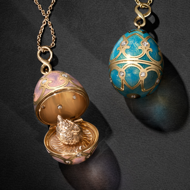Two Fabergé egg pendant lockets from the heritage collection. One with pink guilloche enamel, white diamonds and yellow gold, opened exposing golden hen on the inside. One with turquoise guilloche enamel, white diamonds and yellow gold.