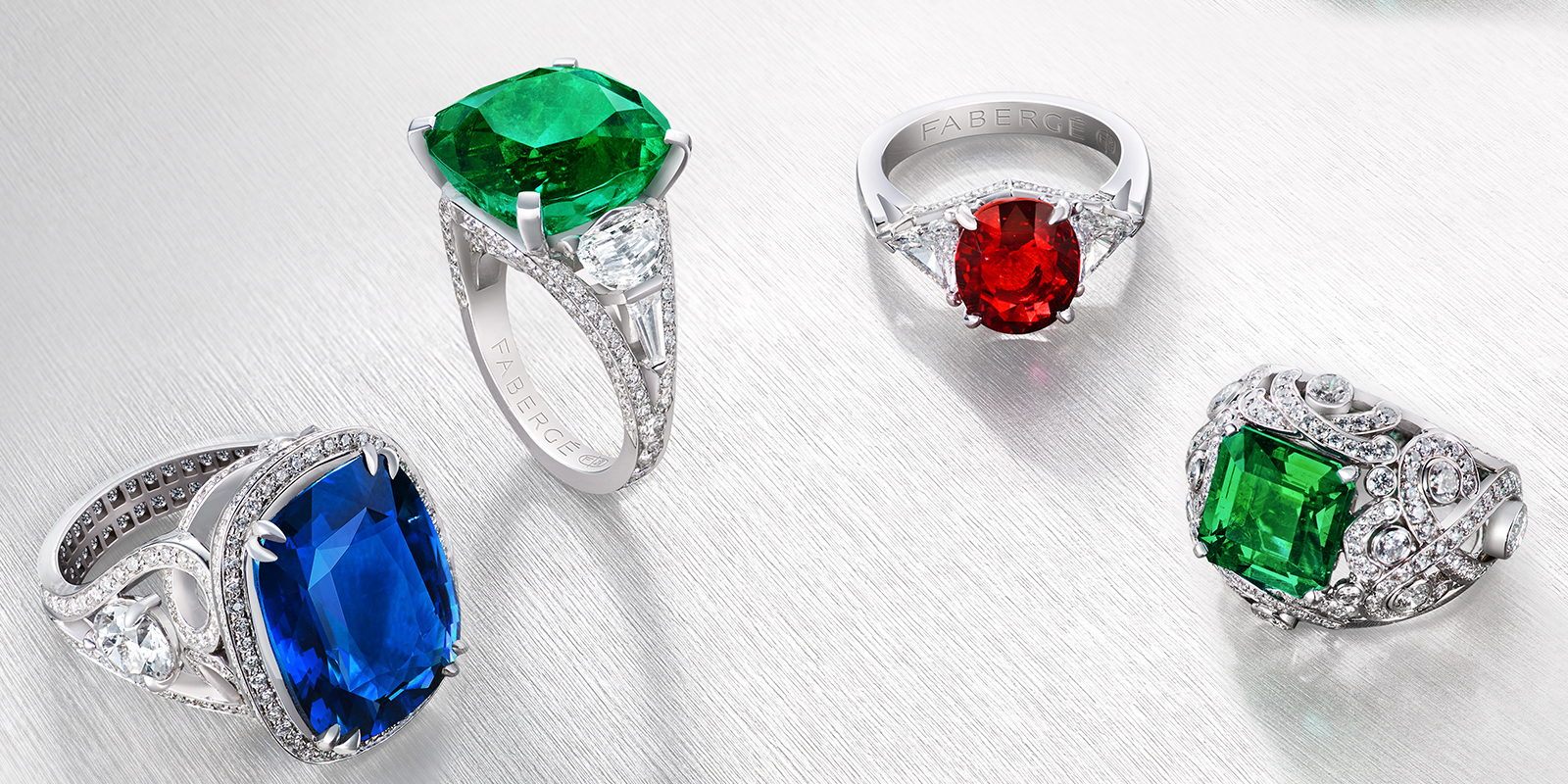 Four rings from the three colours of love collection. One blue sapphire and white diamonds ring, two green emerald and white diamonds rings, one red ruby and white diamonds ring.