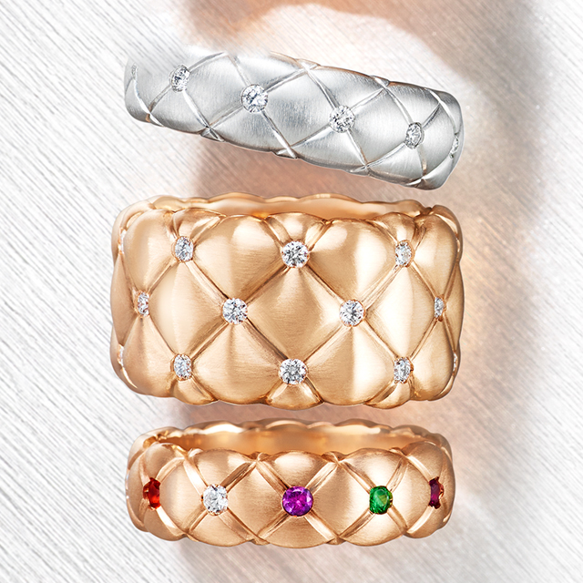 Three rings from the Treillage collection. One white gold and white diamonds thin ring, one rose gold and multi-coloured gemstones thin ring, one rose gold and white diamonds wide ring.