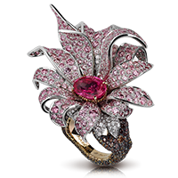 Giant Magnolia Ring – featuring an oval orangy-pink sapphire, white diamonds, pink diamonds, and brown diamonds, set in sterling silver, 18kt pink gold and platinum, in the shape of a magnolia flower.