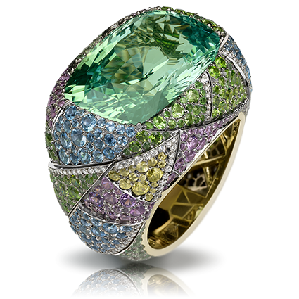 Fabergé Kaleidoscope Ring – features 1 cushion light green antique chrysoberyl, white diamonds, violet spinels, demantoid, sphenes, blue sapphires, aquamarines, and tsavorite set in 18kt yellow and grey gold.