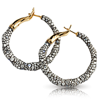 Fabergé Charmeuse Créoles Earrings – hoop earrings featuring white diamonds, moonstones, white rose-cut diamonds, and ruby, set in 18kt yellow gold.