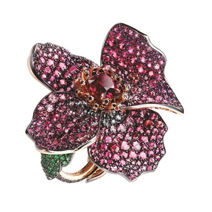 Fabergé New Poppy Ring – features 810 stones, including 1 cushion spinel, garnets, rubies, round spinels, and tsavorites, set in 18kt pink gold and sterling silver in the shape of a poppy flower.