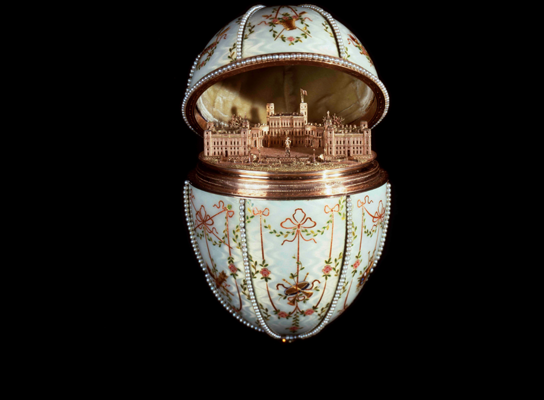 The egg is so named as it opens to reveal a beautifully rendered four-coloured gold model of the Gatchia Palace, the Dowager Empress's winter home near St Petersburg. This lifts out to reveal a velvet-lined open space that would have contained a precious jewel (now lost). The height of the egg is 12.7cm (5in). The workmaster was Mikhail Perkhin.
