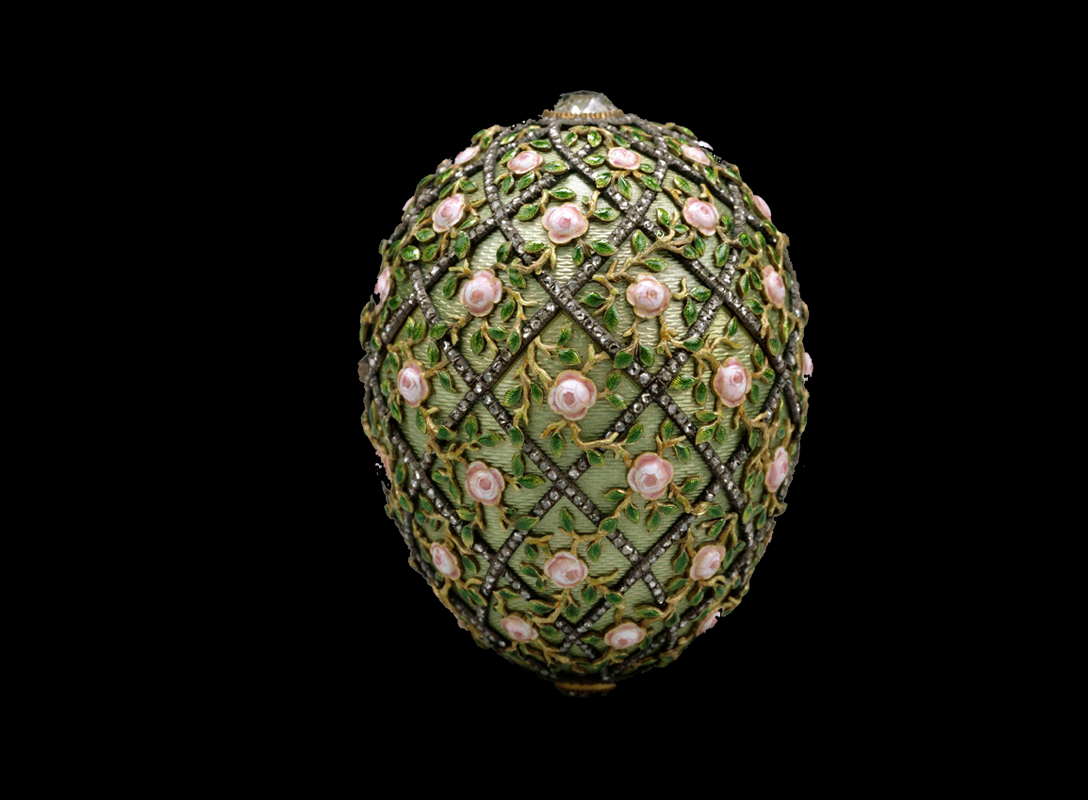 The Rose Trellis Egg was given by Emperor Nicholas II to his wife, the Empress Alexandra Fedorovna, on Easter Day 1907. It is made of gold, the shell is enamelled translucent green over a guilloché ground. Pink enamel roses with emerald green leaves are centred within each lattice created by the diamond-set trellis. Its surprise was a diamond necklace featuring a diamond-set miniature of the Tsarevich Alexei, but it is now missing. The egg has a height of 7.7cm (just over 3in). The workmaster was Henrik Wigström.