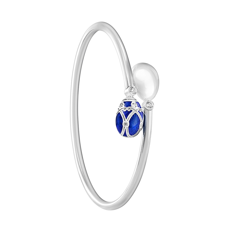 Faberge Palais Yelagin Royal Blue Crossover Bangle – features blue guilloché enamel and white diamonds, set in 18 karat white gold.
