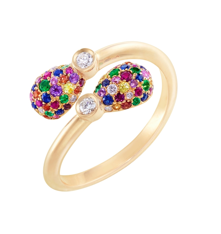 Emotion Multi-Coloured Crossover Ring, features rubies, tsavorites, orange sapphires, yellow sapphires, white diamonds, emeralds, blue sapphires, pink sapphires, and amethysts, set in 18kt yellow gold in a crossover shape.