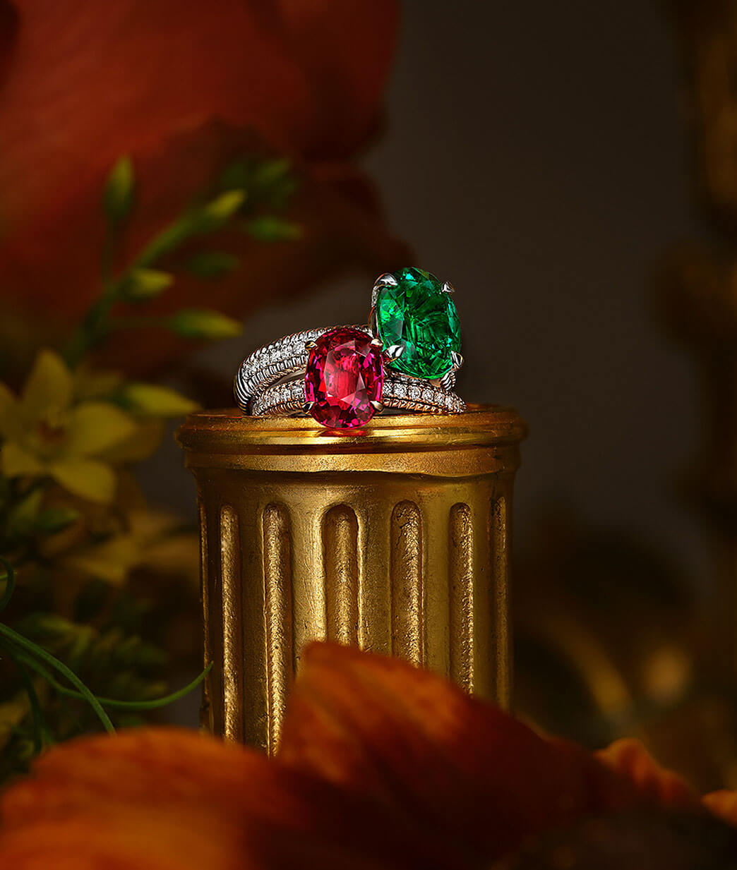 Close up view of two rings from the three colours of love collection. Ring on top: Fluted rose gold band encrusted in small red rubies – Fabergé Ruby Rose Gold Fluted Band. Ring on bottom: Fluted rose gold band encrusted with small white diamonds – Fabergé Diamond Rose Gold Fluted Band.