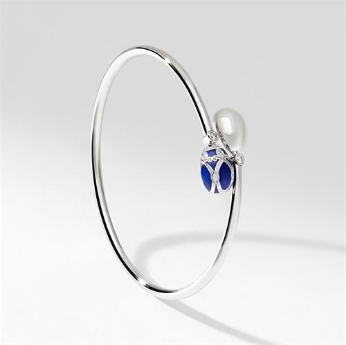 White Gold, Diamond & Blue Enamel Crossover Bracelet   Fabergé